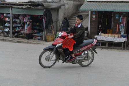 Muang Khua, taking his seat to school